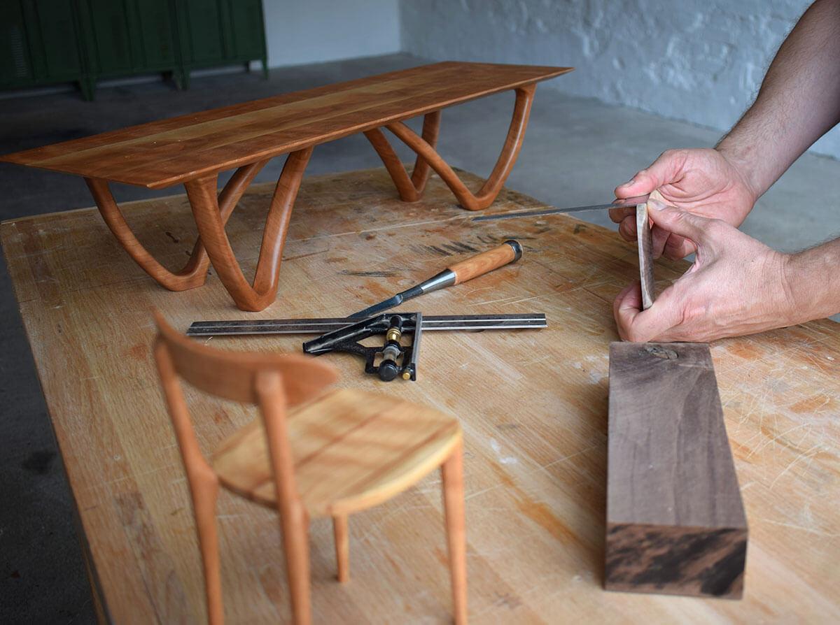 miniature furniture models being made in workshop